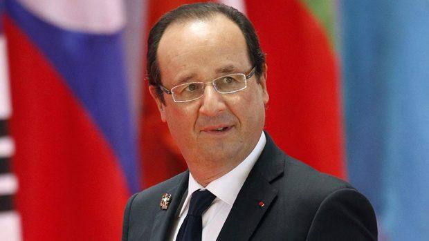 Presiden Prancis Francois Hollande akan mulai membahas pernikahan sejenis tahun depan  (Vincent Thian/Associated Press)