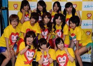 """Sembilan artis porno Jepang berpose dengan tiga di Tokyo pada tanggal 30 Agustus 2014, menjelang """"Boob Aid"""" acara amal untuk pencegahan AIDS.Foto,© AFP Toshifumi Kitamura"""