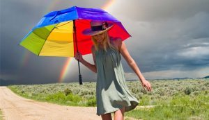 woman-umbrella-rainbow-628x363